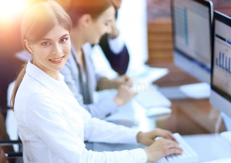 Young employee sitting at a Desk stock images