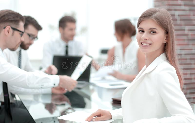 Young employee sitting at his Desk and looking at the camera royalty free stock photo