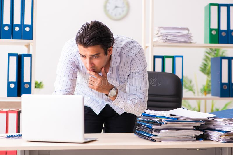 The young employee sitting at the office. Young employee sitting at the office stock images