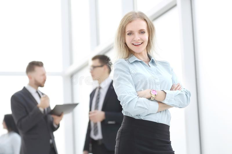 Young employee standing in the lobby office stock photography
