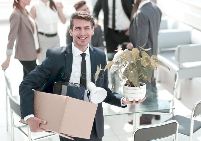 Young employee standing in office on his first day royalty free stock photography