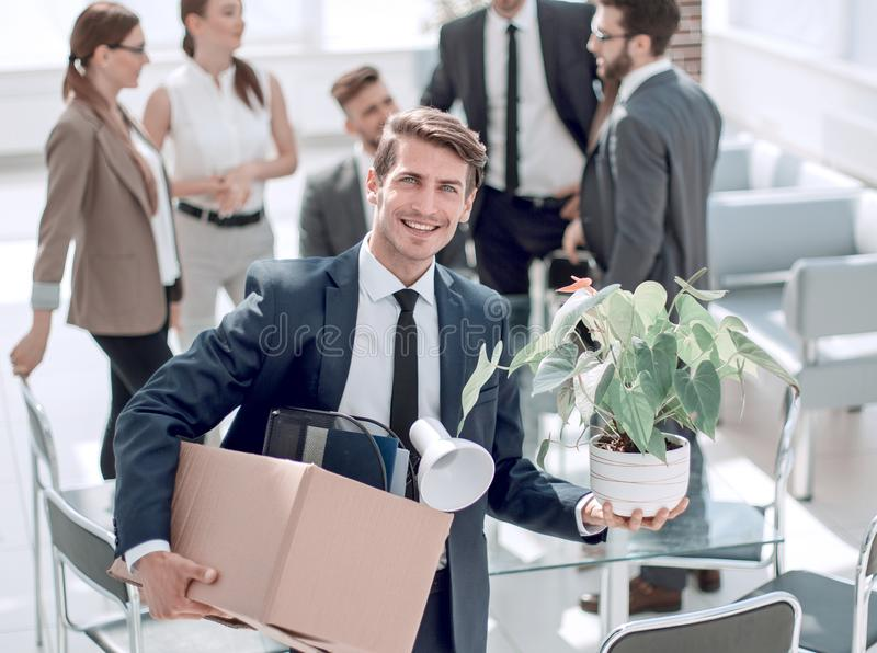 Young employee standing in office on his first day stock photo