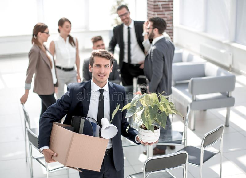 Young employee standing in office on his first day stock photos