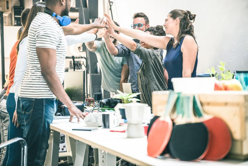 Young employee startup workers group stacking hands at office stock photography