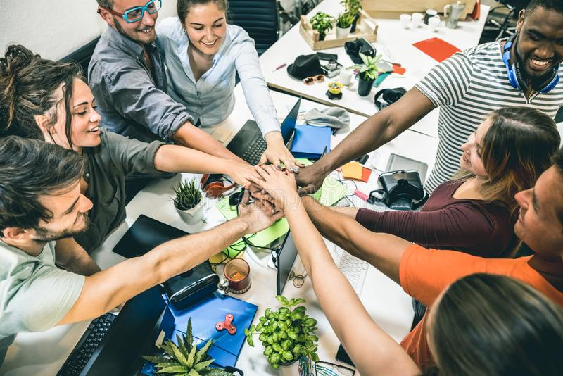 Young employee startup workers group stacking hands at start up office royalty free stock photo
