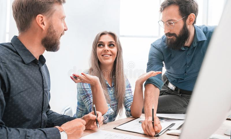 Young employee to her colleagues explaining her ideas stock photo