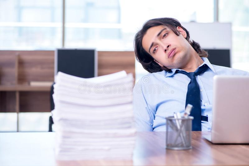 Young employee unhappy with excessive work stock photos