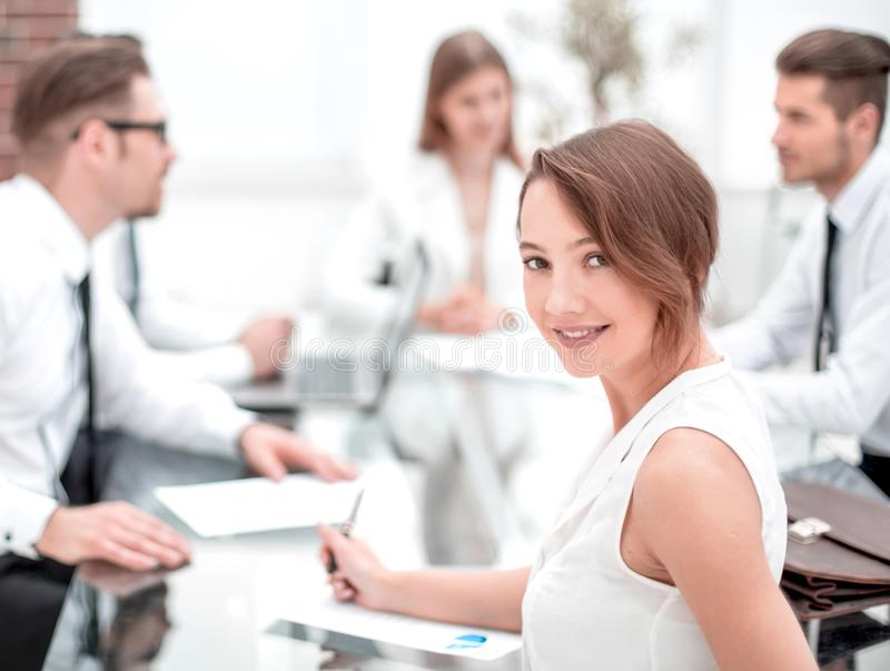 Young employee at a working meeting stock image