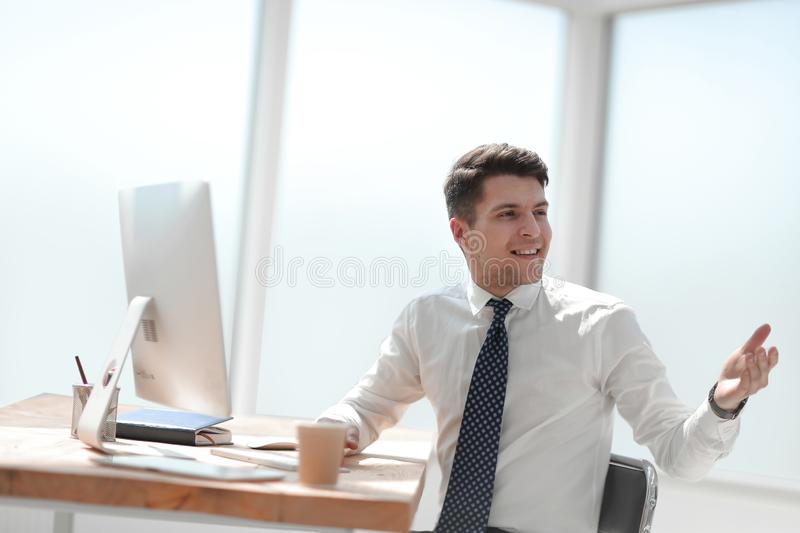 Young employee in the workplace in the office stock photography