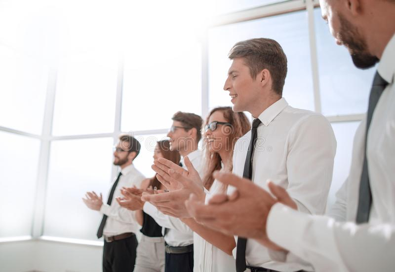 Young employees of the company a standing ovation. Photo with copy space royalty free stock image