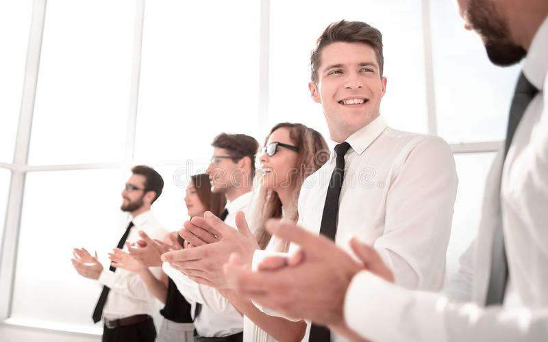Young employees of the company a standing ovation. Photo with copy space royalty free stock photo
