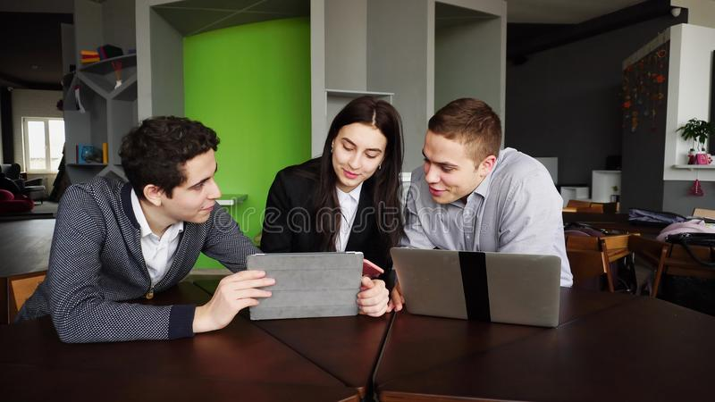 Young employees of company are women and men making tables and c stock photos