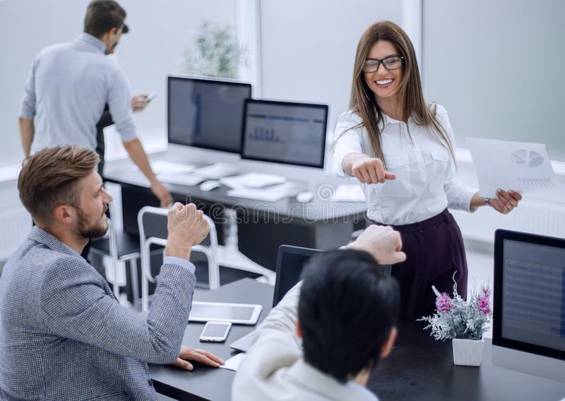 Young employees with a gesture of showing their success royalty free stock photography