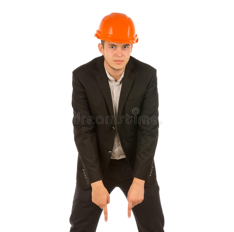 Young Engineer in Black Attire and Orange Helmet. Middle Age Engineer in Black Attire and Orange Helmet Looking at Camera. Isolated on White Background royalty free stock photos