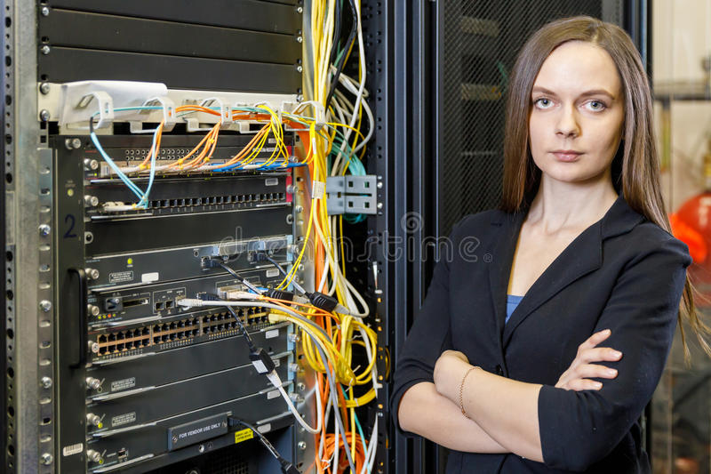 Young engineer and businesswoman at the network equipment stock images
