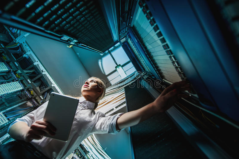 Young engineer businesswoman in server room royalty free stock photos