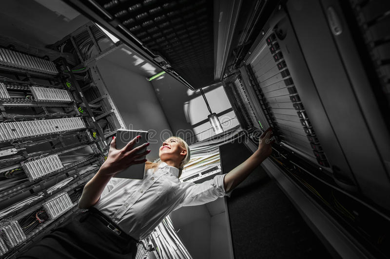 Young engineer businesswoman in server room royalty free stock images