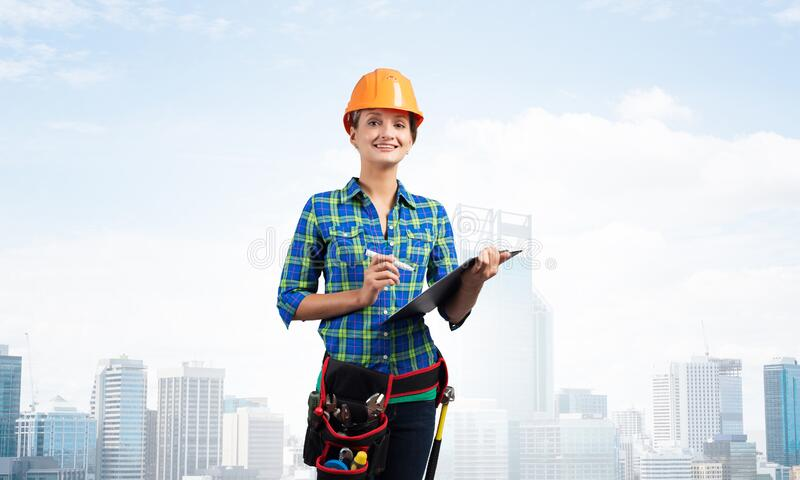 Young engineer in hardhat standing in front royalty free stock image