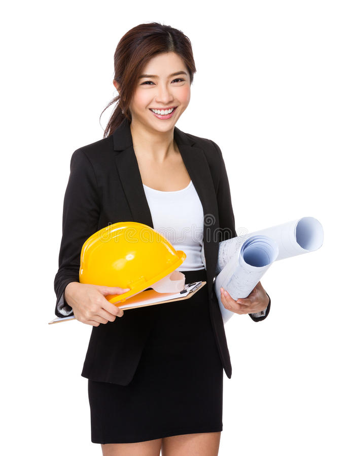 Young engineer with helmet and blue print royalty free stock photography