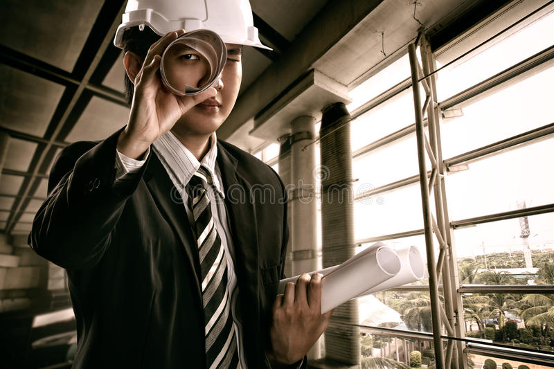 Young engineer. Hold the blueprints stock image