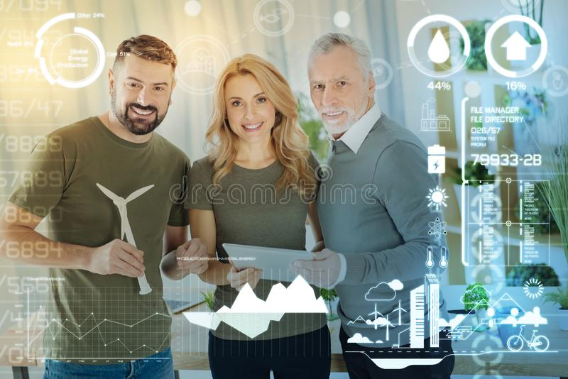 Young engineer holding a miniature windmill turbine stock photography