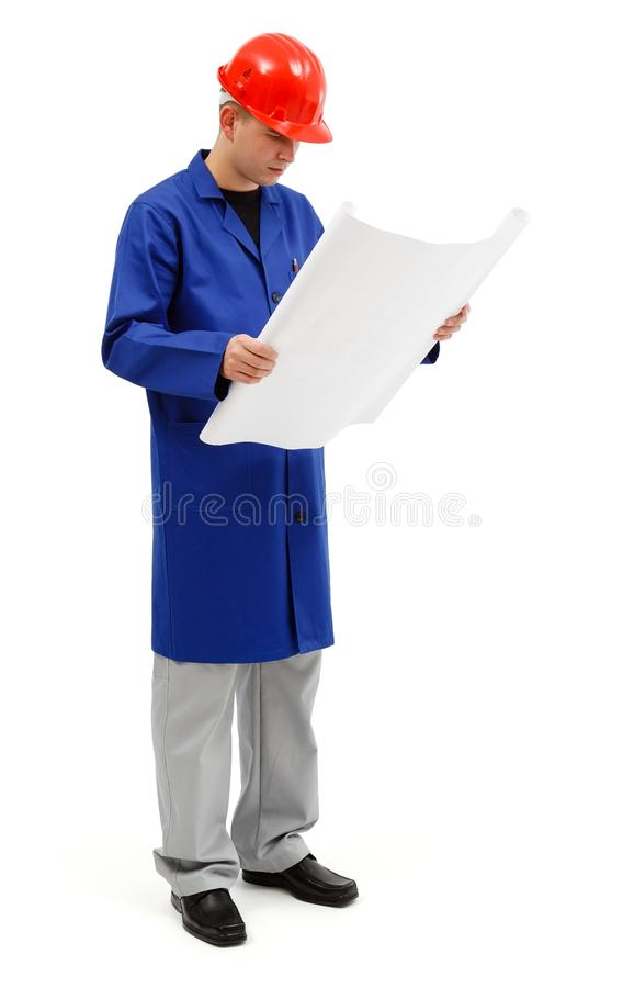 Download Young Engineer Looking At Project Plans Stock Image - Image: 21272759