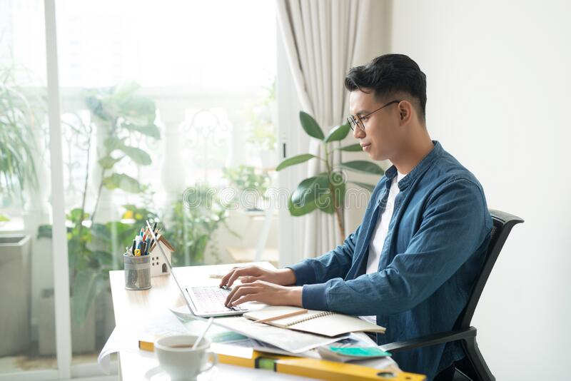 Young engineer man in the office stock photos