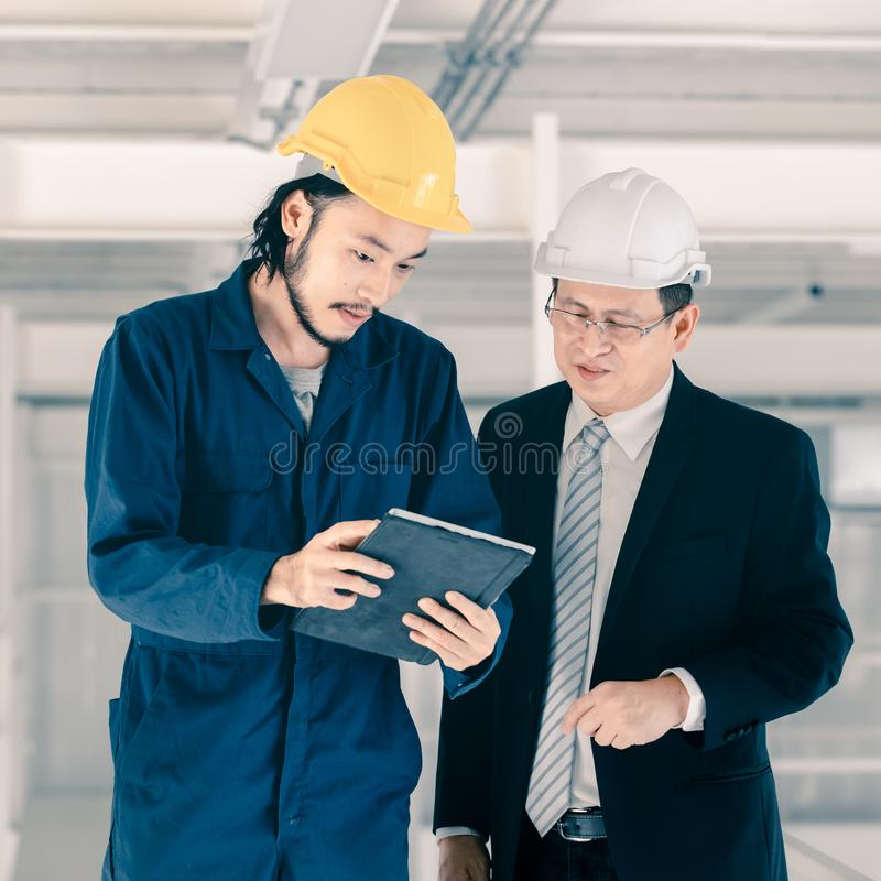 Young engineer present work to executive engineer stock photography