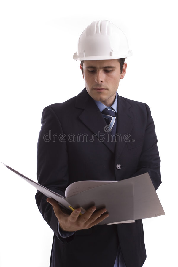 Young Engineer, reading a plan royalty free stock photos