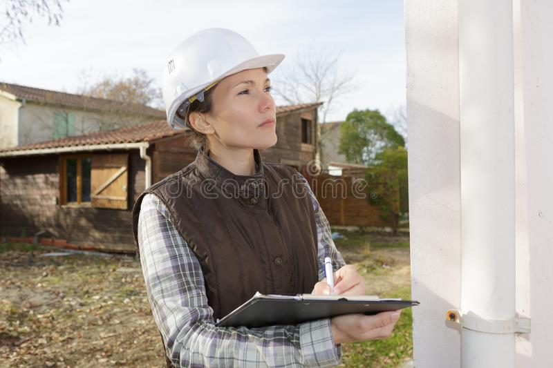 Young engineer woman inspecting construction site stock image