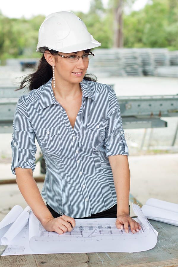 Young engineer woman looks aside stock photos