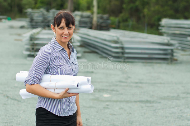 Young engineer woman supervising the yard stock images