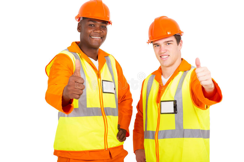 Young engineers thumbs up royalty free stock photos