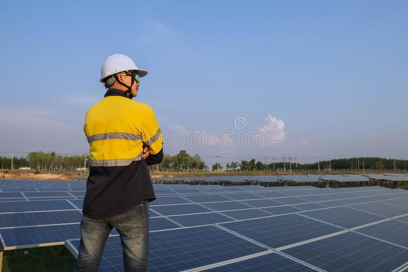 Young engineers who are expert in solar power generation systems, alternative electricity source, concept of sustainable resources royalty free stock image