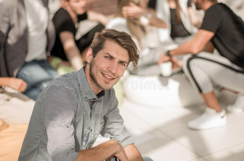 Young entrepreneur on the background of a group of young designers. Photo with copy space royalty free stock image