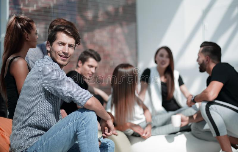 Young entrepreneur on the background of a group of young designers. Photo with copy space royalty free stock images
