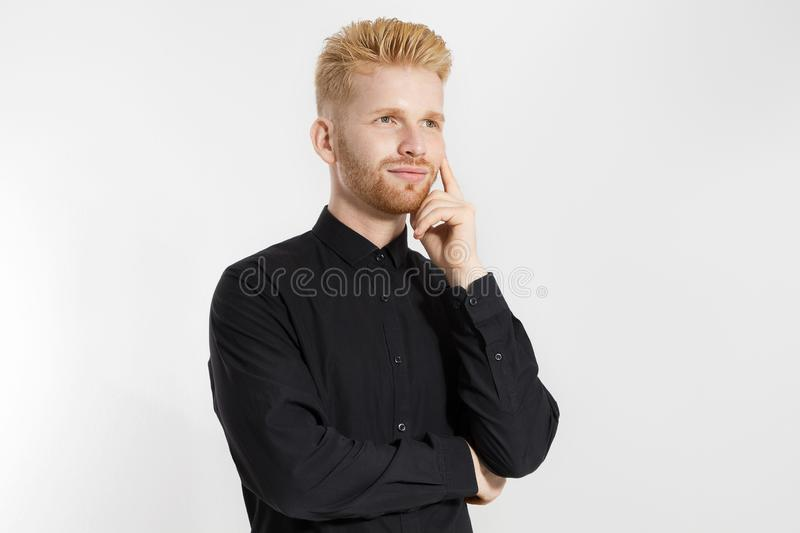 Young entrepreneur Generate Business Ideas. Close up of thinking Man in black shirt  with copy space. Self improvement. And serious male face. Redheaded guy stock photos