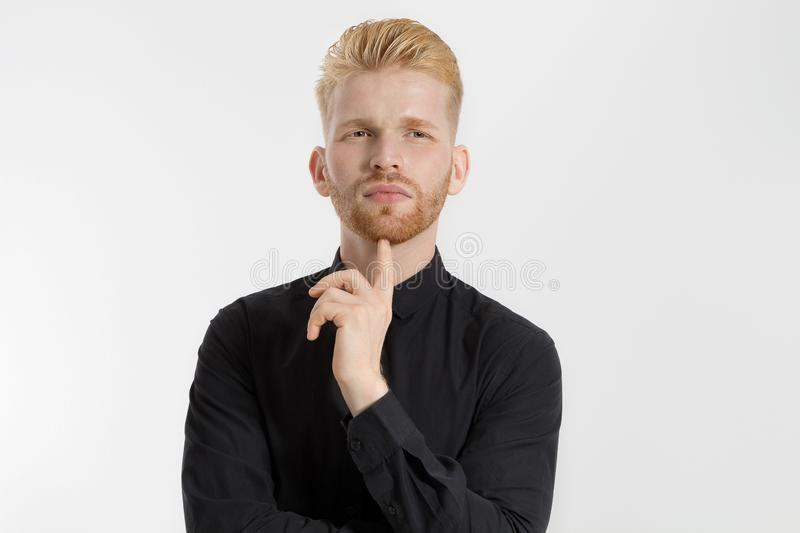 Young entrepreneur Generate Business Ideas. Close up of thinking Man in black shirt isolated with copy space. Self improvement. And serious male face. Redheaded stock photos