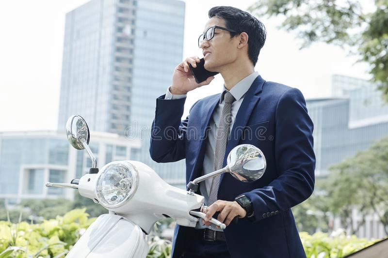 Young entrepreneur making phone call stock photo