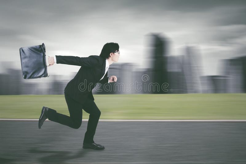 Young entrepreneur running on the road stock image