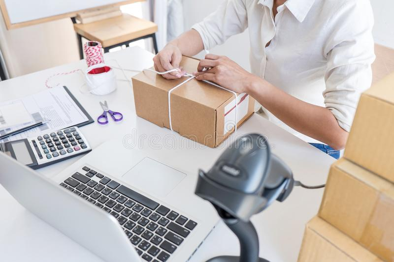 Young entrepreneur SME receive order client and working with packaging sort box delivery online market on purchase order and. Preparing package product, Small royalty free stock photo