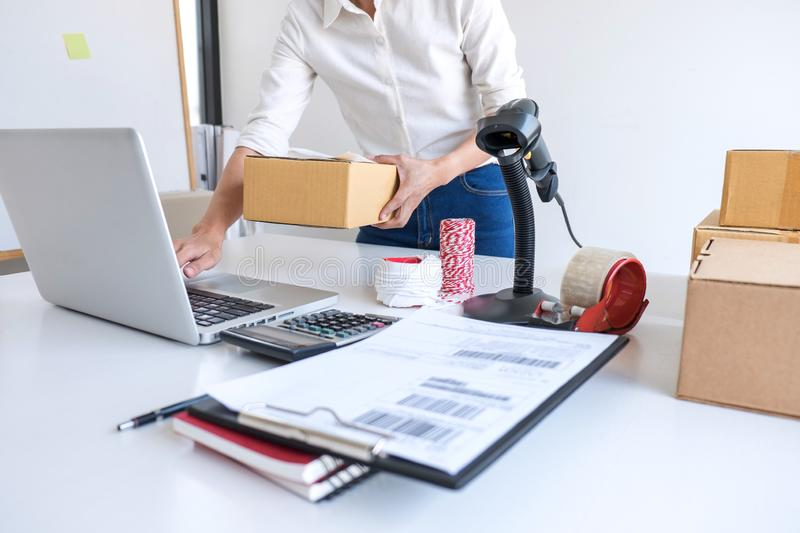 Young entrepreneur SME receive order client and working with packaging sort box delivery online market on purchase order and. Preparing package product, Small stock photography