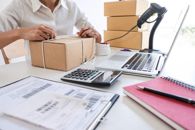 Young entrepreneur SME receive order client and working with packaging sort box delivery online market on purchase order and. Preparing package product, Small royalty free stock images