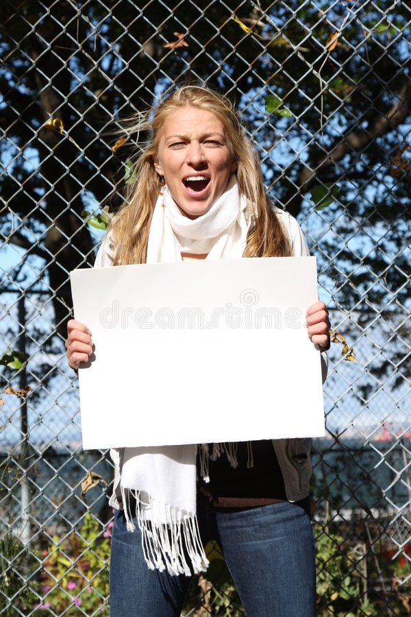 Young environmentalist girl. Young female environmentalist expressing eco-minded ideas. She is holding a blank sign - just type in your own message royalty free stock photography