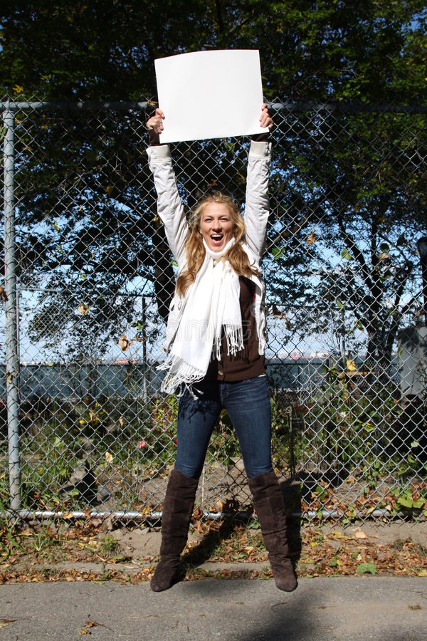 Young environmentalist girl. Young female environmentalist expressing eco-minded ideas. She is holding a blank sign - just type in your own message stock photography