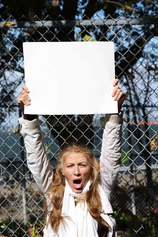 Young environmentalist girl. Young female environmentalist expressing eco-minded ideas. She is holding a blank sign - just type in your own message royalty free stock images