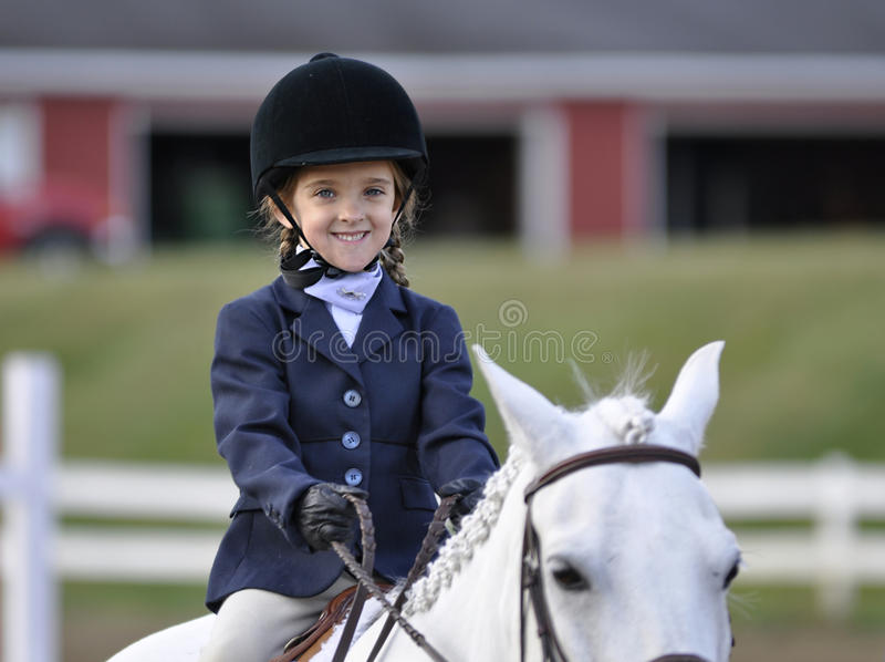 Young equestrian girl on white horse royalty free stock images