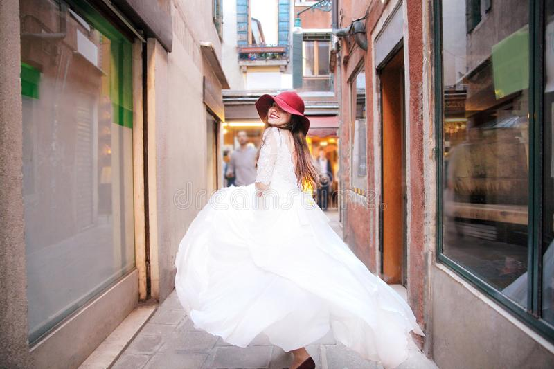 Wedding. Young european bride is walking in Venice. Italy stock images
