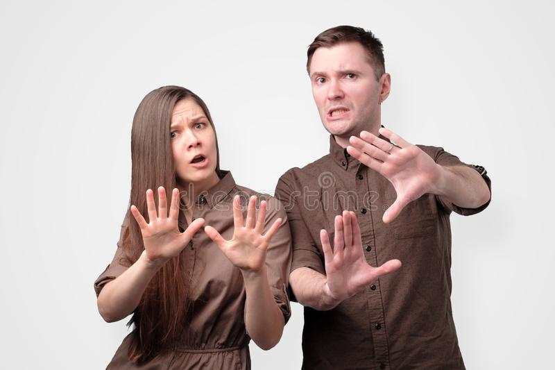 Young european couple showing refusal gesture to stop stock image
