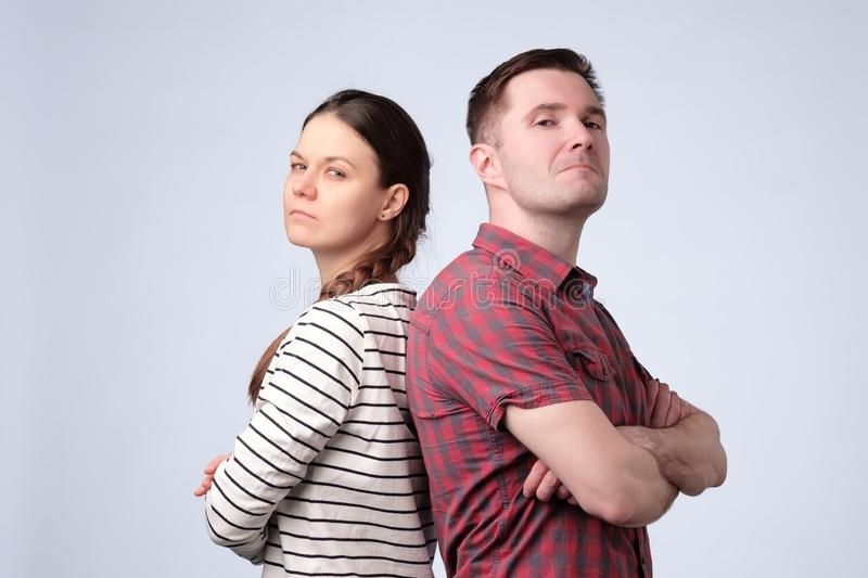 Young european couple standing against white gray background royalty free stock image